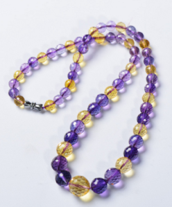 "Synthetic ametrine -- no color variation within individual beads, and the ""citrine"" element is more yellow than golden."