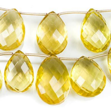 Brilliant yellow lemon quartz briolette beads.