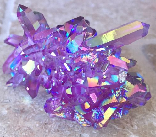 We think amethyst aura quartz is one of the prettier varieties!
